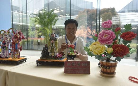 上合青岛峰会新闻中心的中国元素 助力传统文化走向世界